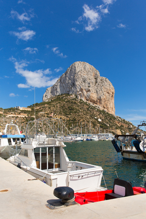 Calp Spain marina with boats and Penon de Ilfach the famous rock landmark on the Costa Blanca Фото со стока