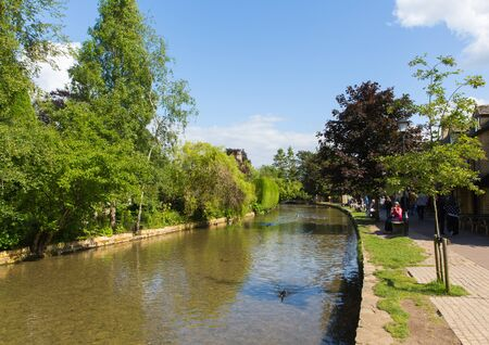 Bourton on the Water Cotswolds Gloucestershire England UK beautiful summer sunshine and fine weather attracted visitors on Tuesday 12th June 2018