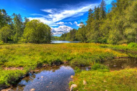 The Lake District National Park England uk near Hawkshead with river in colourful HDR