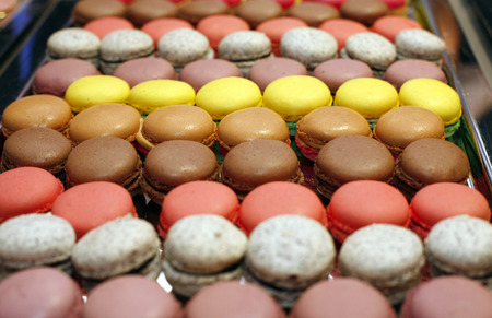 Traditional french macarons in a rows  Colorful macaroon background photo