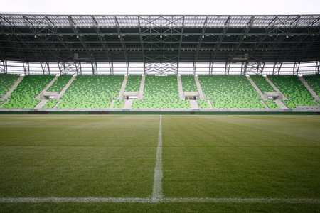 Empty green bleachers at stadium  photo