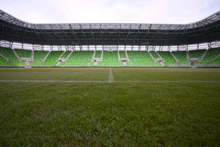 bleachers:  Empty green bleachers at stadium