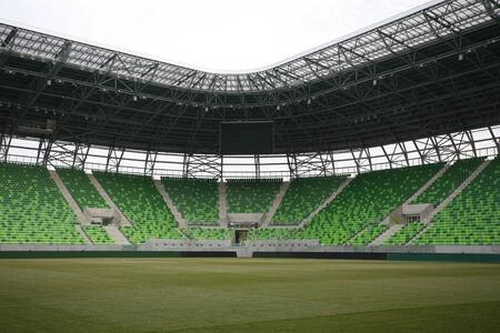 Stadium with grandstand  Empty green bleachers at stadium  photo