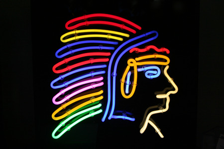 redskin:  Native American redskin chief in a neon light sign advertisement