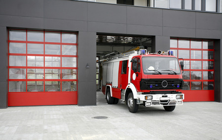 Emergency fire rescue truck. Fire-fighting vehicle on fire-station Archivio Fotografico
