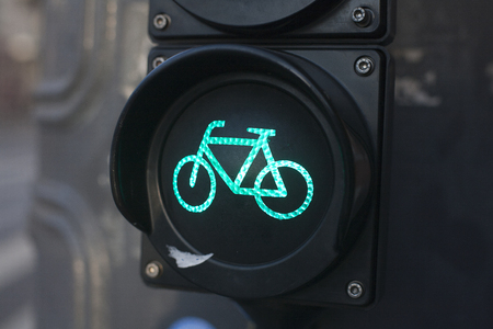 Green light for bycicle lane on a traffic light photo