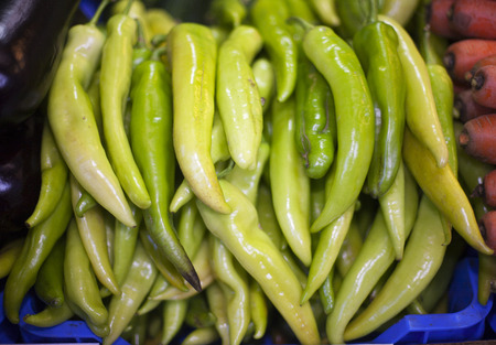 Hot green peppers in raw at a farmers market photo