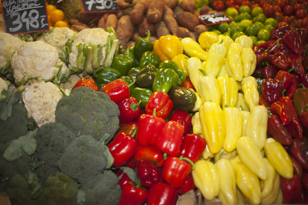 Vegetables and fruits in row at a farmers market photo