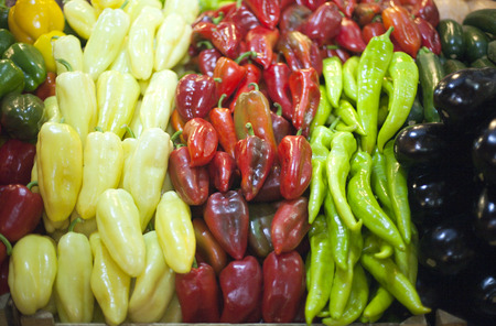 Peppers in row at a farmers market photo