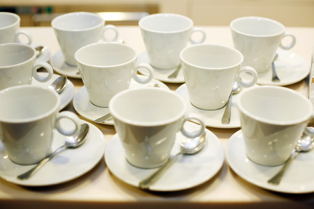 Coffee cups and saucers at an event photo
