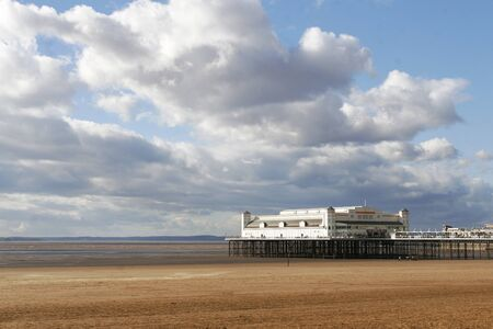 weston super mare: Low tide at the traditional seaside pier at Weston-super-mare UK Editorial