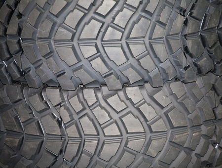 4wd: Four wheel drive tire stack as a background. 4WD tyres.  Part of brand new car tyre. Tire Track Off Roa Stock Photo