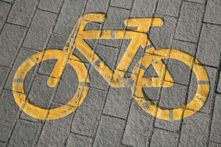 cycler: Bicycle way symbol on city street as a background