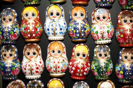 matrioshka: Colorful russian wooden dolls at a market . Matrioshka Babushkas dolls are the most popular souvenirs from Russia