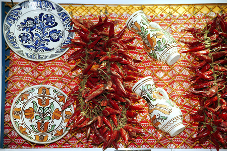 folk art: Artistic traditional folk art objects and red hot spicy organic  paprika on market stall Stock Photo