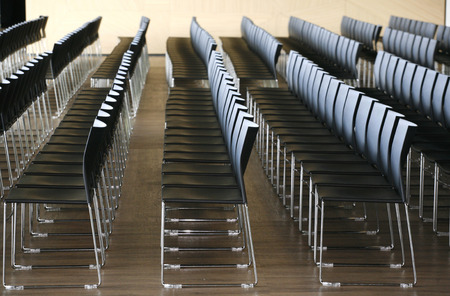 Endless rows of chairs in a modern conference hall photo