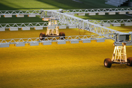 lighting system: Mobile lighting rig system for growing grass and lawn in empty stadium
