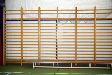 wall bars: Closeup of wall bars in a high school gymnastic hall Stock Photo