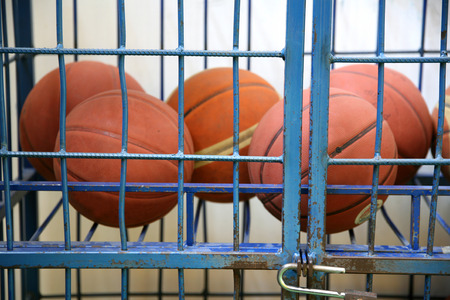 school gym: Old rubber basket balls in a school gym like a prison Stock Photo