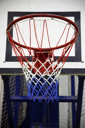 school gym: Basketball hoop in a high school gym.