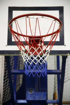 school gym: Basketball hoop in the  high school gym Stock Photo