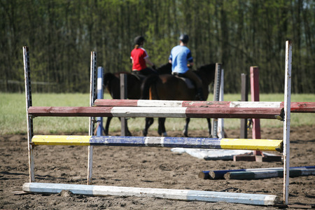 obstacles: Obstacles and barriers in row on a horse jumping show