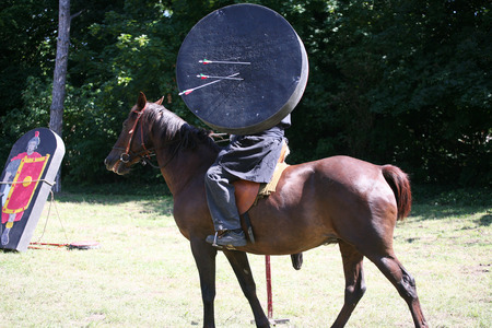 Unknown horseman warrior with a mobile target Stock Photo