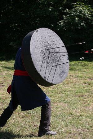 Bowman with a mobile target on a medieval warrior show