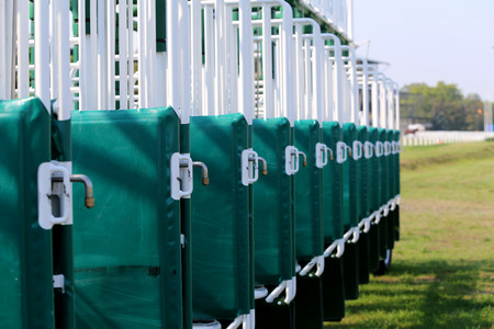 Horse track and starting gates as a background 免版税图像 - 46633034