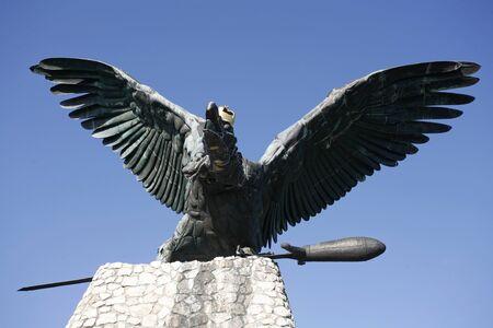 legendary: Statue of the famous hungarian legendary Turul bird against blue sky