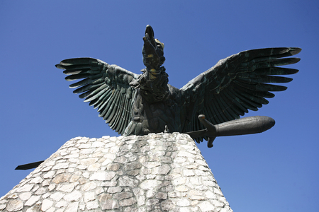 legendary: Statue of the famous hungarian legendary Turul bird against blue sky