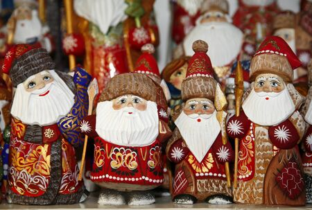 christmas market: Army of wooden puppets of Santa Claus at Christmas market