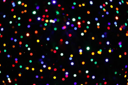 merry mood: Festive christmas background with natural bokeh bright colorful lights Stock Photo