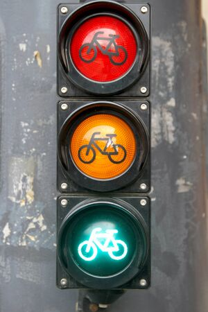 Traffic light with bike sign for cyclists close up.Red yellow green light for bycicle lane Imagens