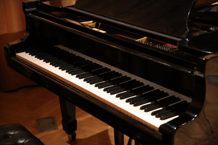 Close up of a grand piano with black and white piano keys