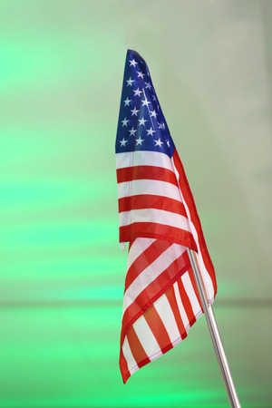 Flag of United States of America against green background