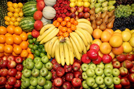 Big assortment of fresh organic fruits. Frame composition of fruits on market stall Archivio Fotografico