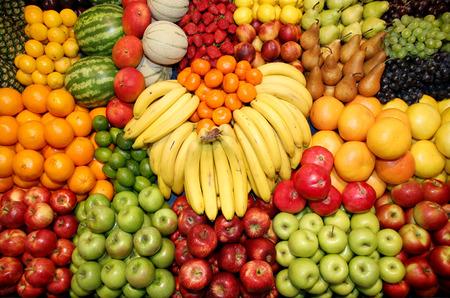 Big assortment of fresh organic fruits. Frame composition of fruits on market stall Standard-Bild