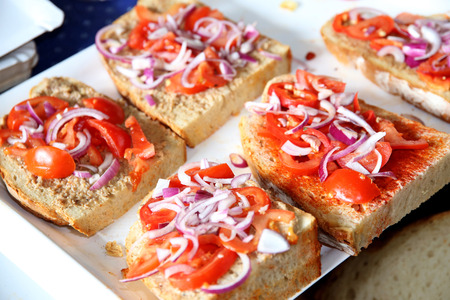 gastro: Fast food as bread and dripping with tomatoes and onions. Swallow depth of fields