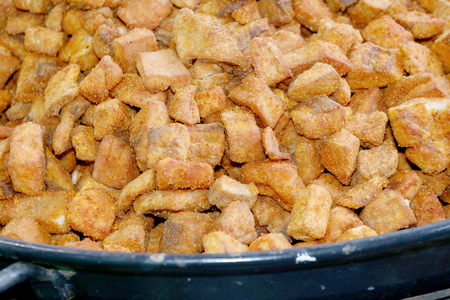 greaves: Closeup of boar greaves cracklings in bowl Stock Photo