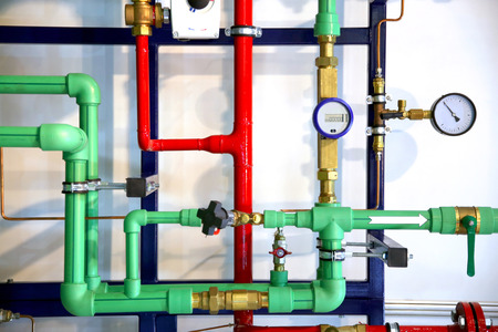 Colored pipes and heating system demo as a background 免版税图像 - 55169317