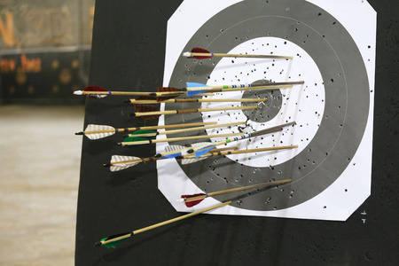 bowstring: Set of arrows for the sports of archery in middle of the target