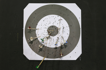 bowstring: Black and white target with arrows As a background