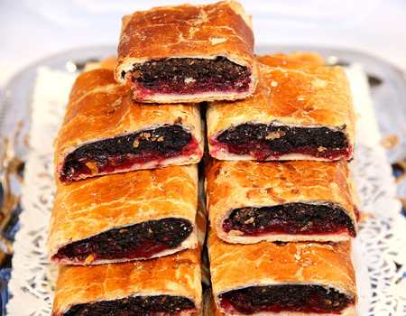 poppy seeds: Strudel with poppy seeds and sour cherry on plate at rural retail market Stock Photo