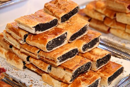 poppy seeds: Strudel with poppy seeds on plate at rural retail market
