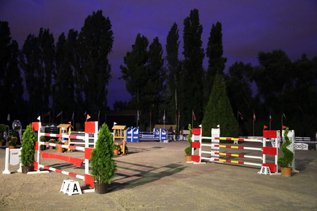 obstacles: Show-jumping obstacles in the evening Stock Photo