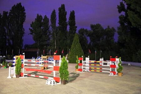 without people: Obstacles and barriers on a show jumping field without people