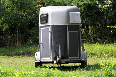 Horse trailer at courtyard. Transportation for horses by trailer Stock Photo