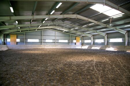 without people: Riding hall with sandy covering without people Stock Photo