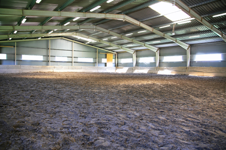 Empty riding arena is suitable for dressage horses